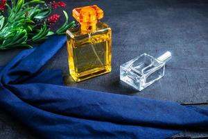 Perfume in gold and clear bottles