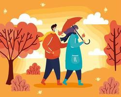 Pareja joven con mascarillas en una escena de otoño