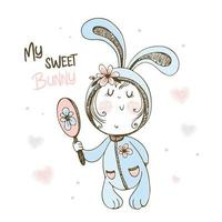 Cute baby in pajamas bunny admiring in the mirror.