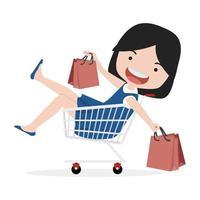 linda chica sentada en el carrito de compras