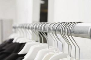 Jackets hanging on rail close-up photo