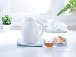 Home appliance kettle in kitchen interior