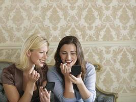 Two Smiling Women Putting On Makeup