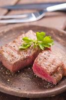 Rare beef steak on rustik plate