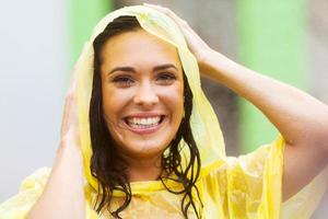 young woman in raincoat outdoors
