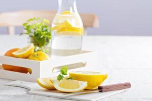Cut lemons on a cutting board photo
