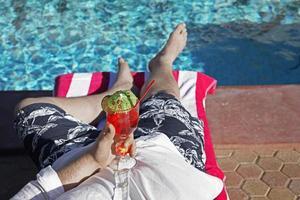Mid Adult Man Having Cocktail at Pool