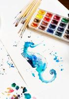 Watercolor painting of blue seahorse