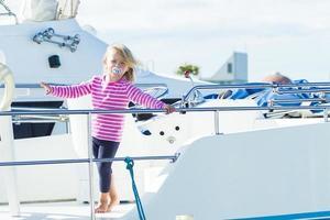 blonde girl playing on an italian yacht photo