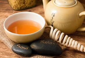 Tea set on wooden board and lava stones photo