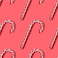 bastón de caramelo sobre un fondo rojo