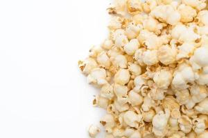 Caramel popcorn on white background photo