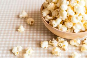Bowl of caramel popcorn on the table photo