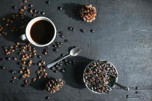 Cup of coffee and coffee beans flatlay