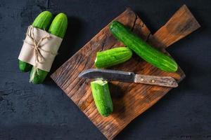 Fresh cucumber on a wooden cutting board
