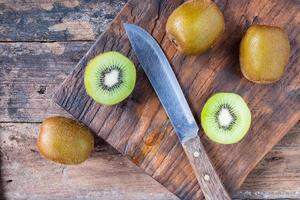 Fresh kiwifruit cut in half.