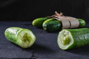 Fresh cucumber on black background