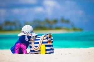 Beach bag and accessories on a beach photo