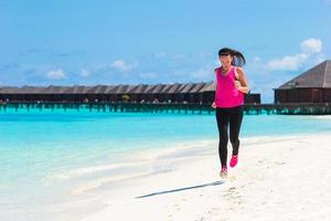 Maldives, South Asia, 2020 - Woman running on a beach resort