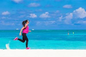 Woman running on a beach photo