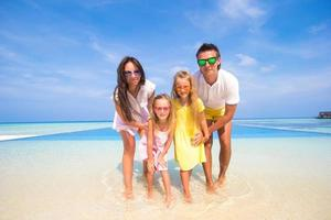 Family in water at a tropical beach