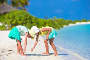 Two girls playing in the sand photo