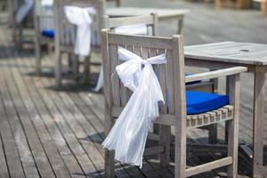White bows on chairs photo