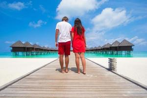 Maldives, South Asia, 2020 - Couple walking on a beach jetty