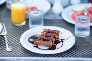 Plate with waffles and chocolate on it