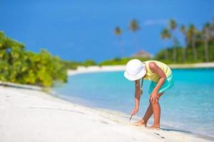 Girl playing in white sand photo