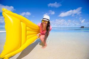 Woman holding a floatie photo