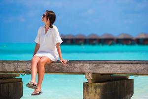 Woman relaxing on a bridge
