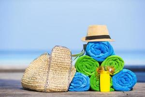Stacked towels and beach accessories photo