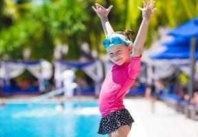 Girl having fun at an outdoor swimming pool