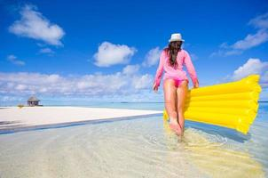 Woman walking in water at the beach photo