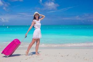 Woman walking with her bag on a tropical beach