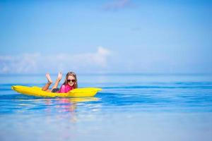 Girl laying on a floatie in the water