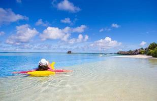 Woman relaxing on a floatie