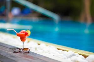 Red cocktail at a swimming pool