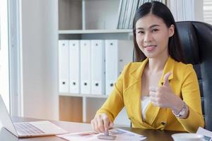 Confident and beautiful business woman photo