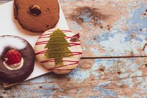 Holiday donuts on wooden table photo