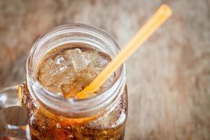 Glass jar of cola photo