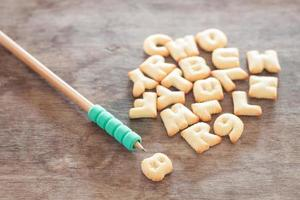 Alphabet biscuits with a pencil