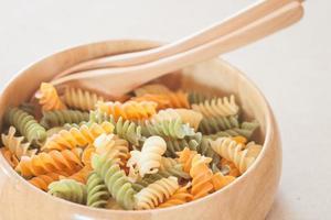Fusilli pasta in a wooden bowl
