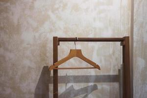 Wooden hanger on beige wall