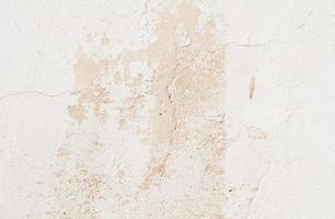 Cracked white concrete wall texture