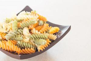 Black plate with pasta