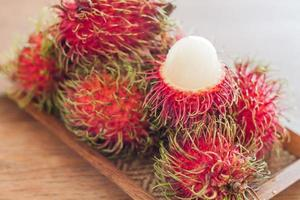 Rambutans on a wooden tray