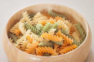 Raw fusilli pasta in a bowl