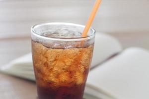 Glass of soda with ice photo